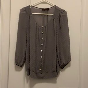 Gray 3/4 sleeve top. See through.